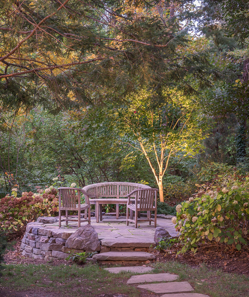 This stone terrace provides a quiet, secluded seating area for a glass of wine in early fall.