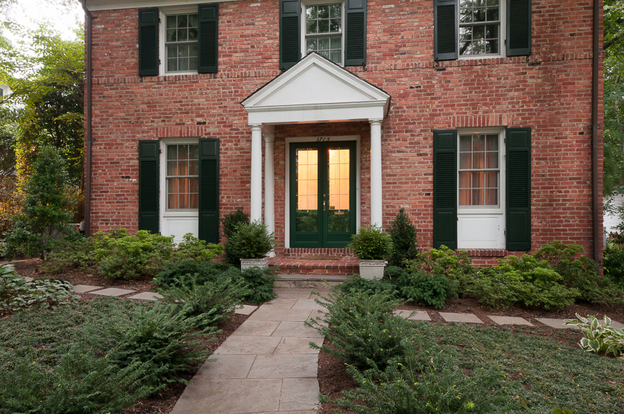 Simple evergreen plantings in the front yard complement the understated elegance of the home's facade.